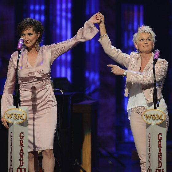 Pam Tillis and Lorrie Morgan perform at the Grand Ole Opry in 2013.