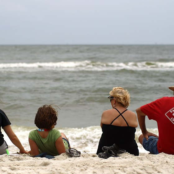 The gentle surf attracts relaxed beach-goers to Dauphin Island.