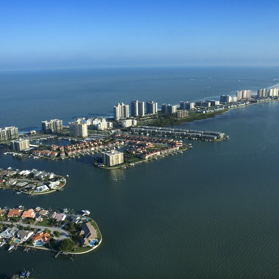 Clearwater Beach is located on a Gulf of Mexico barrier island lined with piers and jettys.