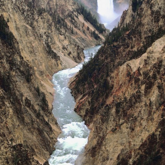 The Yellowstone River flows through Yellowstone Canyon, creating multiple waterfalls.