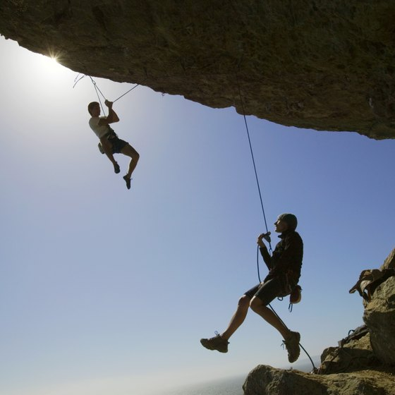 Rappelling involves using ropes to descend rock faces.