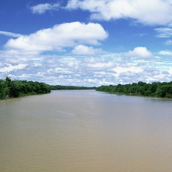 The Amazon River runs through the heart of the Amazon Rainforest.