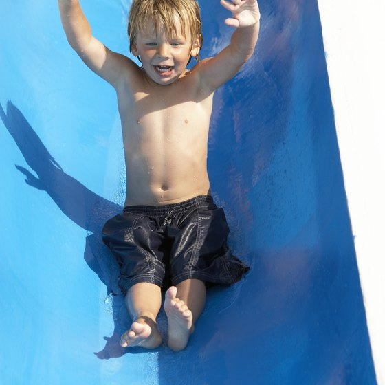 Treat your child to a trip down a water slide.