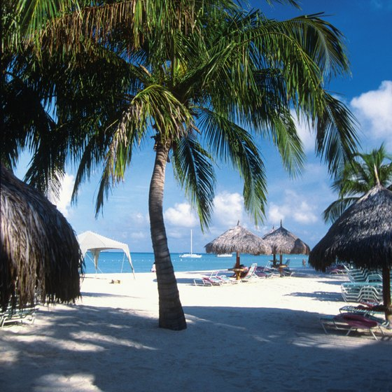 Aruba's white sand beaches attract swimmers and sunbathers.