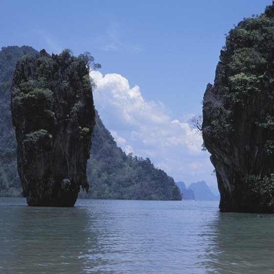 Snorkel off the coast of Koh Phi Phi among stunning rock formations.