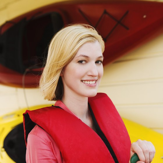 Slip on a life preserver before your river kayak adventure.