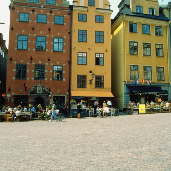 Visitors to Old Town Stockholm enjoy lunch in an open-air cafe.