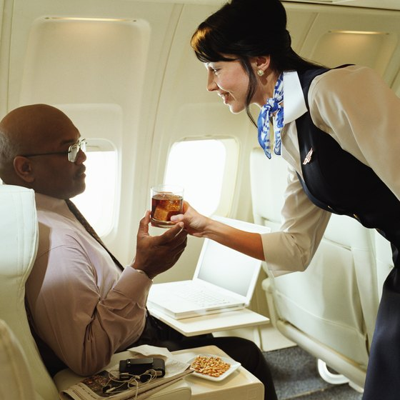 Business class travelers often receive complementary services aboard the plane.
