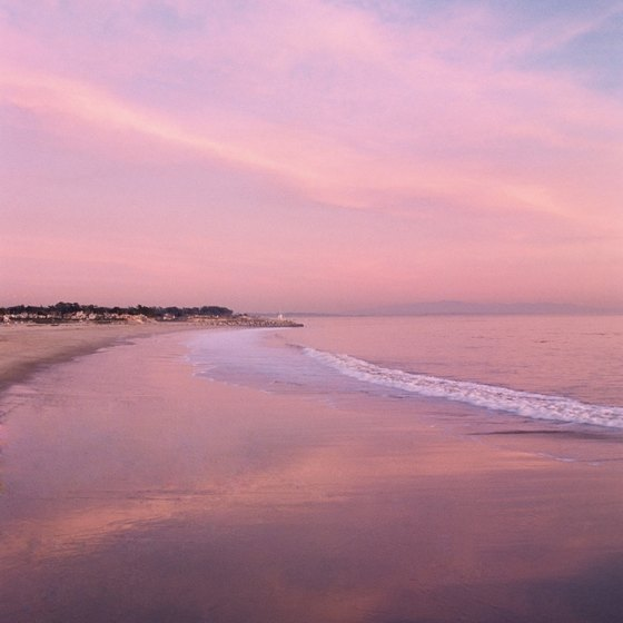 Catch a picturesque Pacific sunset at one of the beaches in Surf City, USA.