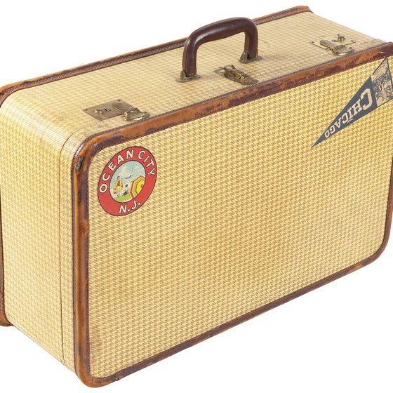 Decoupage travel stickers to your vintage suitcase.