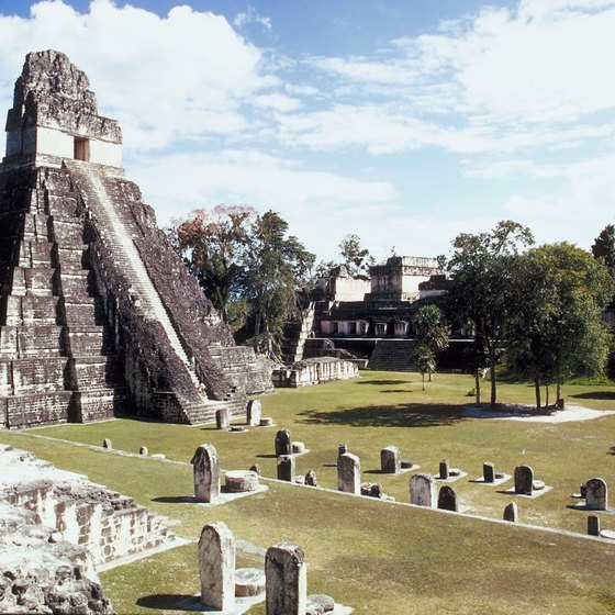 A pyramid at Tikal soars above the Mayan plaza ruins.