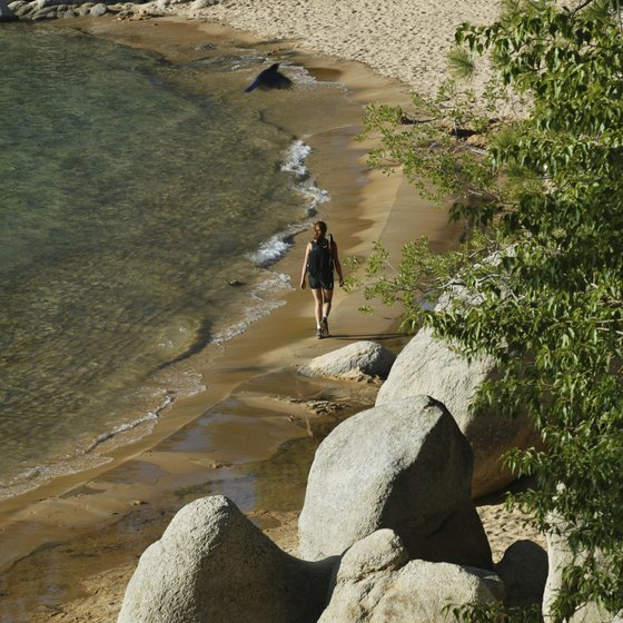 A hiker on the shore of Lake Tahoe