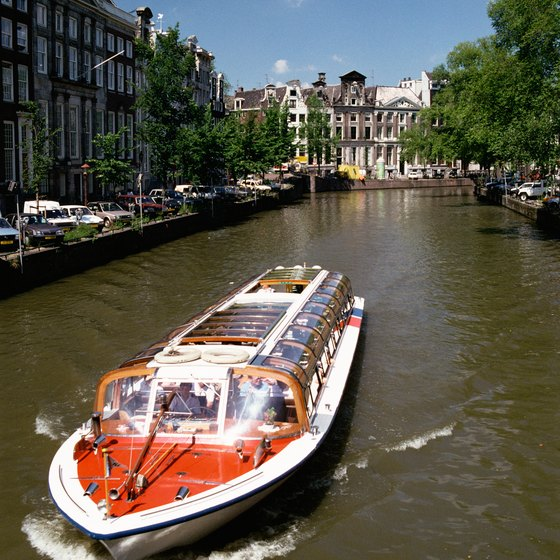 A canal cruise through Amsterdam gives visitors chances to snap photos.