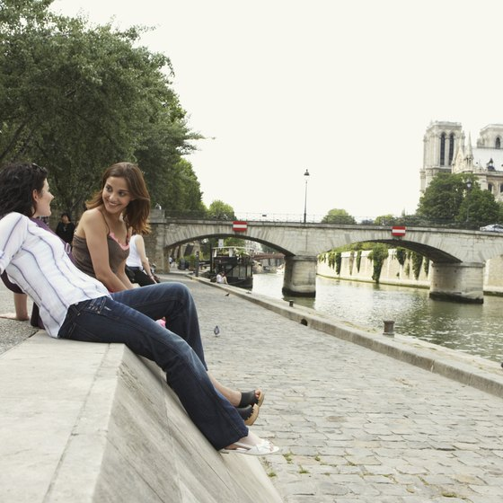 Sitting On The Banks Of Seine In Paris Is A True French Experience