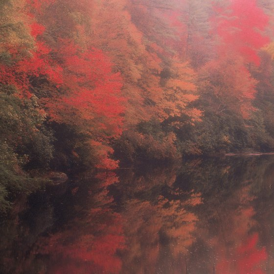 The Linville River reflects the colors of changing leaves.