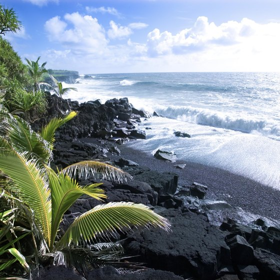 The Big Island's black sand beaches look very different from the usual white sand postcard settings.