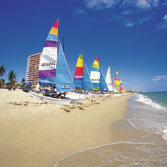 Catamarans rest on a Fort Lauderdale beach, just 10 minutes from Davie.