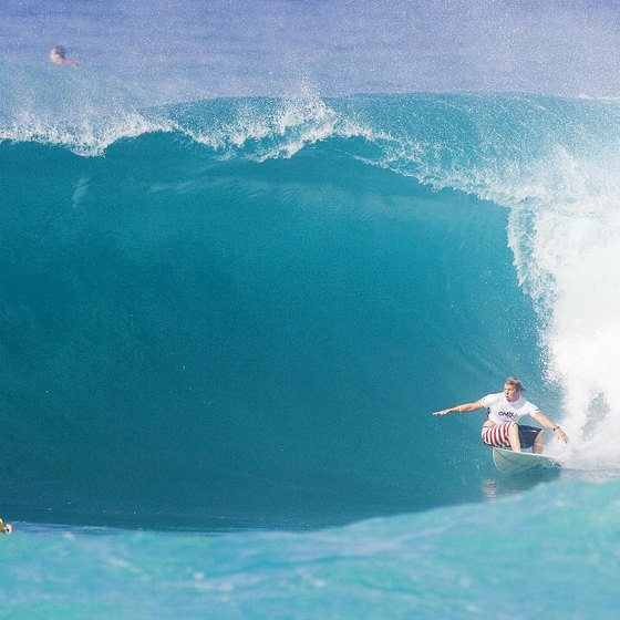 Surfers compete in O'Neill World Cup at Sunset Beach near Turtle Bay.