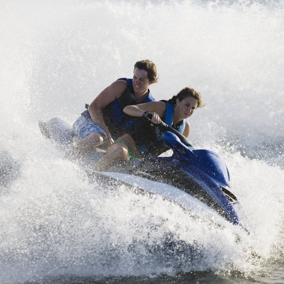 A jet ski allows riders to tour a large body of water on a vessel smaller than a boat.