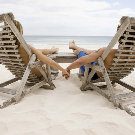A couple relaxes on a seaside beach.