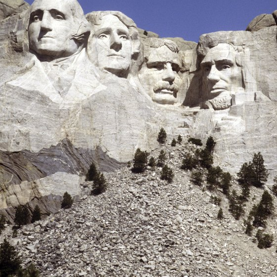 The sculptures on Mount Rushmore stand hundreds of feet high.