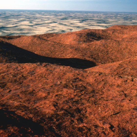 The Australian Outback is full of massive red sandstone formations like Uluru.