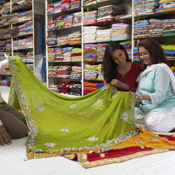 Beautiful fabrics are cheap in India --- you might wait until you arrive to pick up a shawl or a versatile pair of loose trousers.