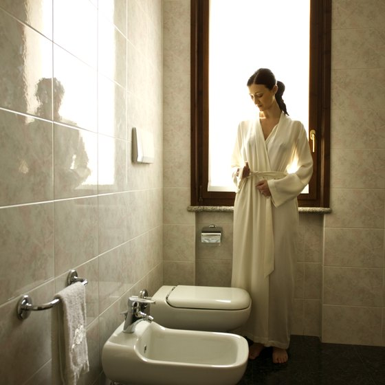 European-style bathrooms typically feature tile on both the floor and walls.