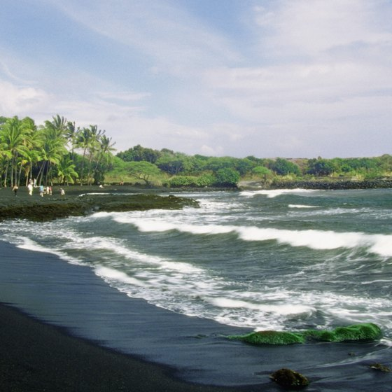 Volcanic black sand is a striking difference between beaches in Hawaii and Miami.