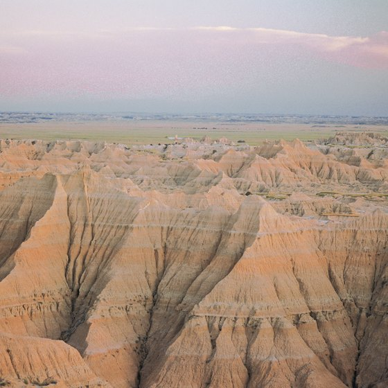 Red bands are layers of paleosols, fossilized soils, whereas tan bands may contain sandstone or white volcanic ash.