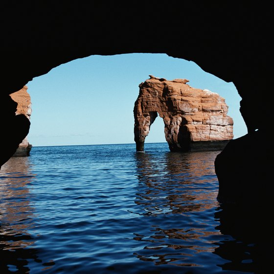 Sea caves are formed by the eroding action of waves.
