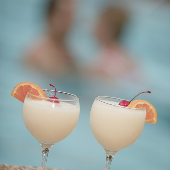 Enjoy pina coladas by the pool included with most all-inclusive Mexican vacations.