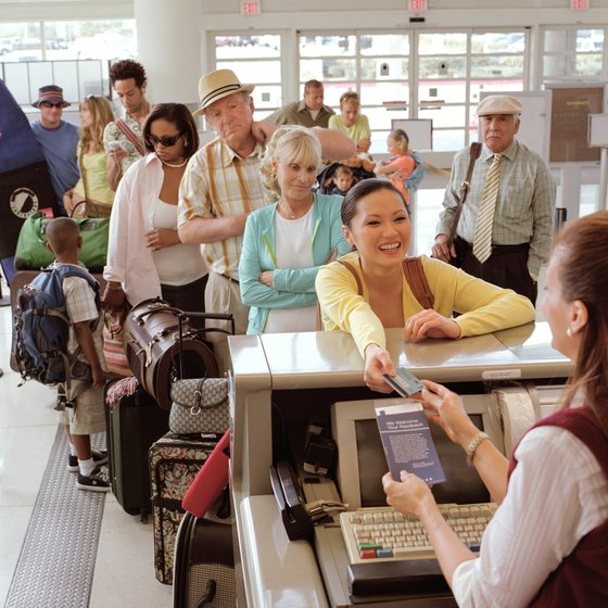Checked baggage is handed over at the ticket counter or curbside, with a skycap.
