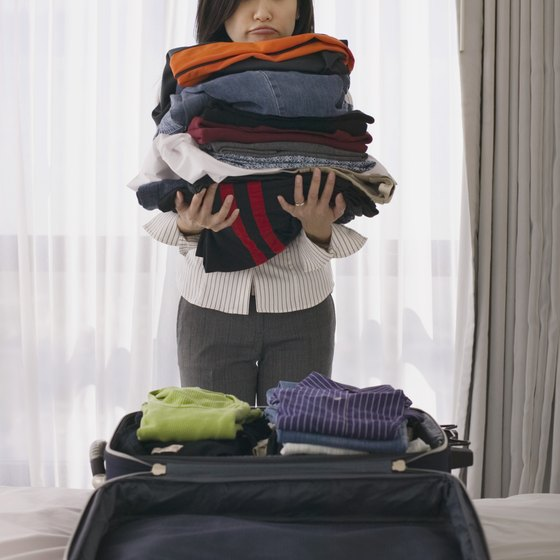 Rolling your clothes together instead of folding them one by one helps fit more in your carry on.