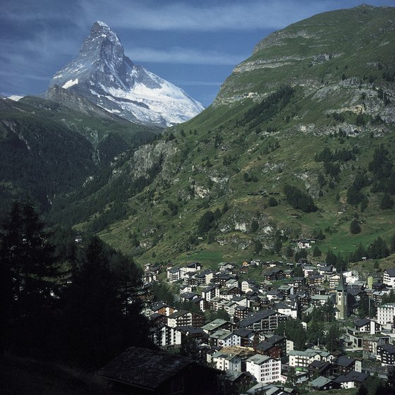Quaint villages lie in the shadow of the Swiss Alps.
