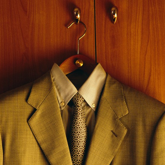 steaming your suits in the shower gets rid of loose wrinkles