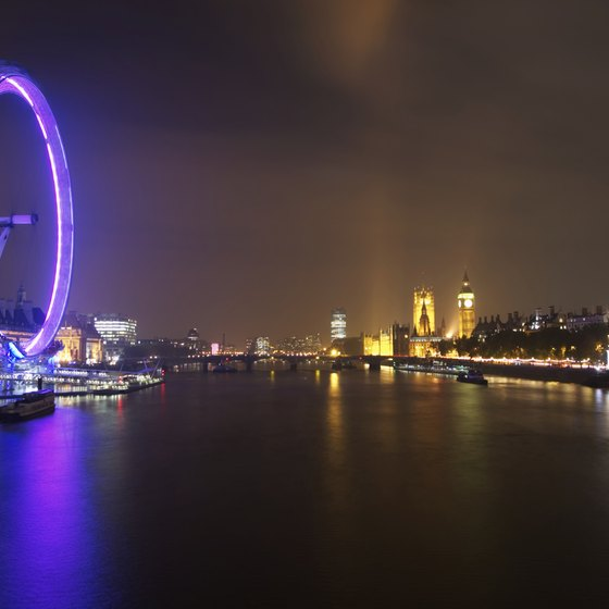 At night the London Eye offers panoramic views of the illuminated city.