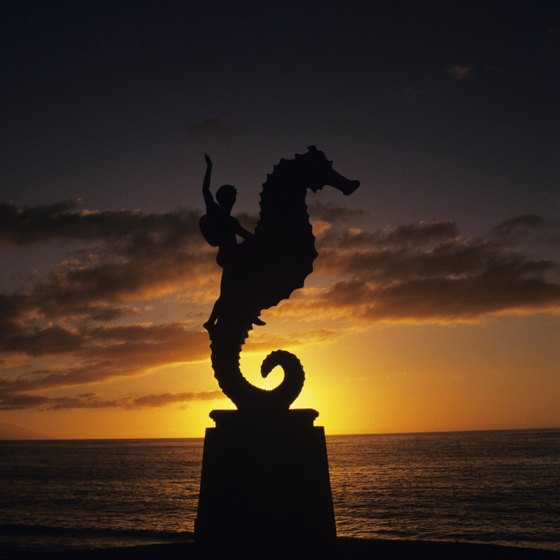Beach sculpture at sunset on Puerto Vallarta beach.