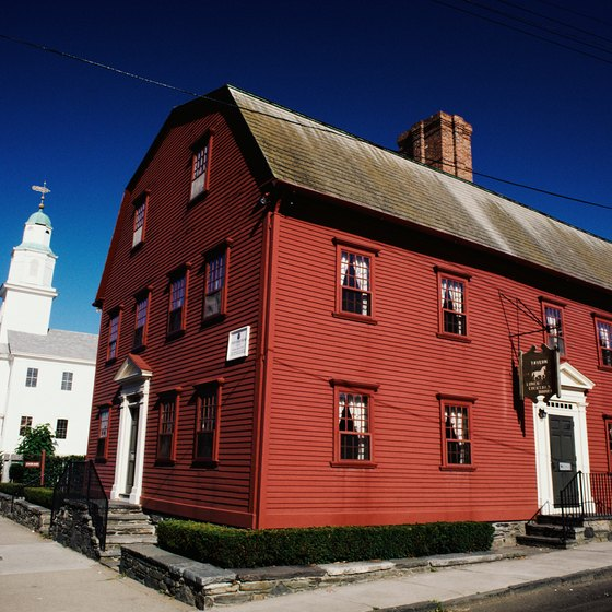 Visitors to Newport, Rhode Island can explore its historic center and elegant mansions.
