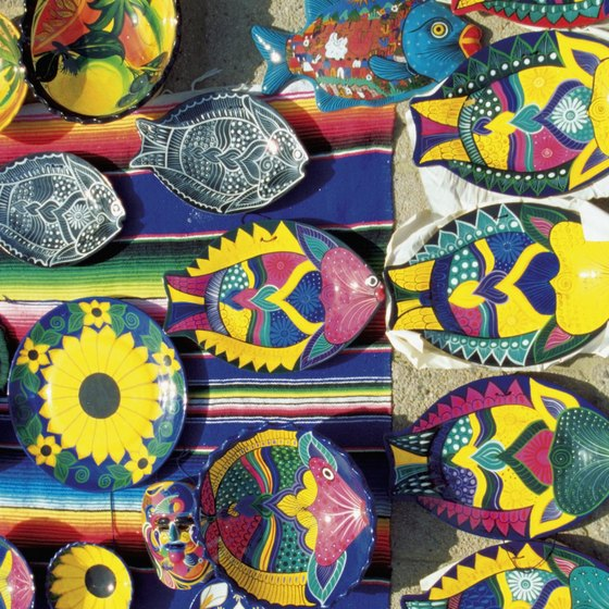 Colorful hand-painted wall hangings add Mexican flair to your home.