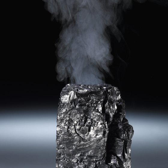 Coal is a rock formed from the carbon remains of plants that decayed under wetlands.