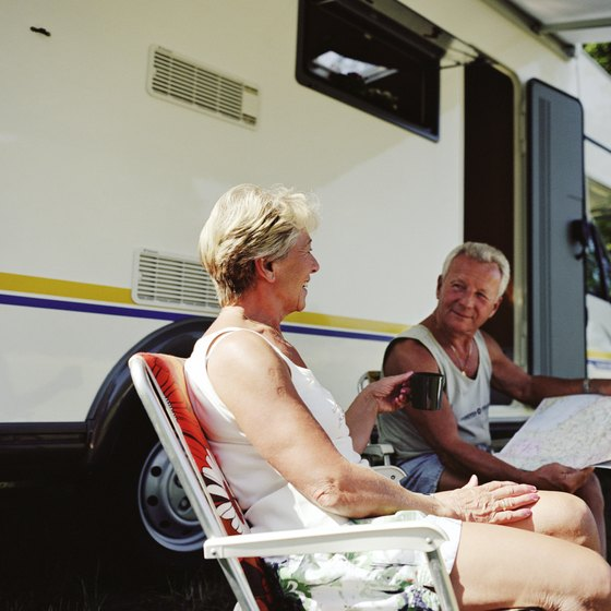 A couple enjoys their RV parking spot.