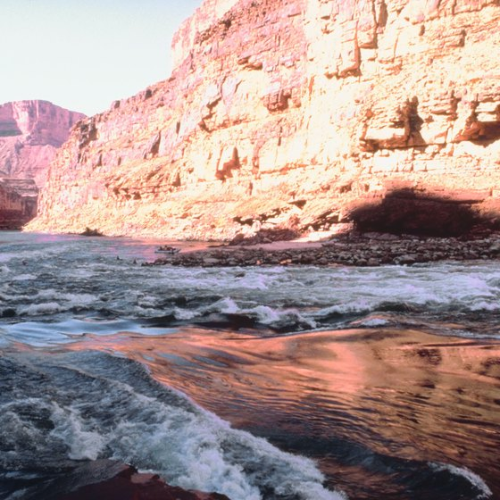 The Colorado River runs through the Grand Canyon, one mile below the canyon rim.