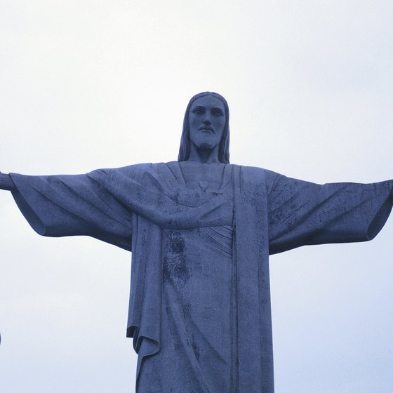The Christ the Redeemer statue sits high above the city of Rio de Janeiro on Corcovado Mountain.