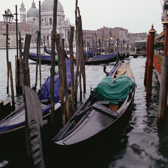 On the island of central Venice, tourists take gondola taxis to get around.