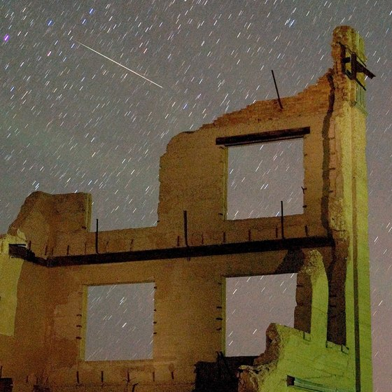 The Rhyolite ghost town during a meteor shower.
