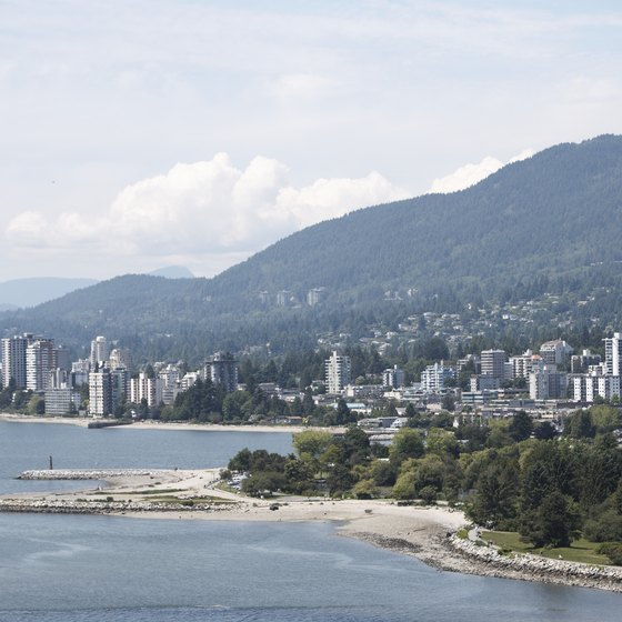 Vancouver, BC sits along the water and next to mountains.