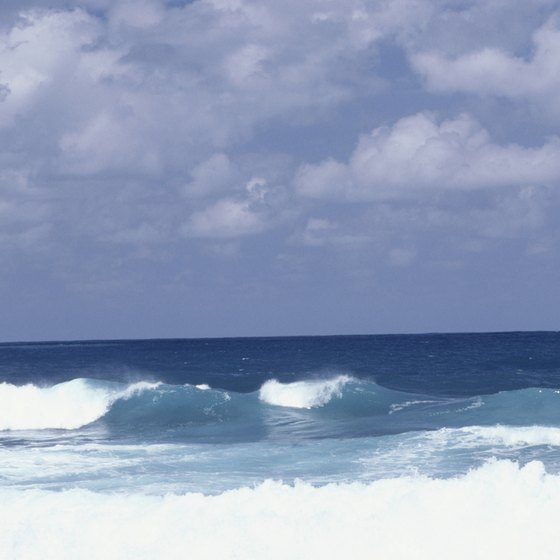 Smaller waves and sandy bottoms are best for beginner surfers.