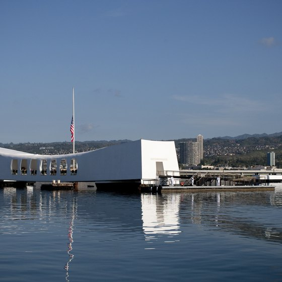 The USS Arizona Memorial sits right above the sunken ship that claimed the lives of 1,177 crewmen.