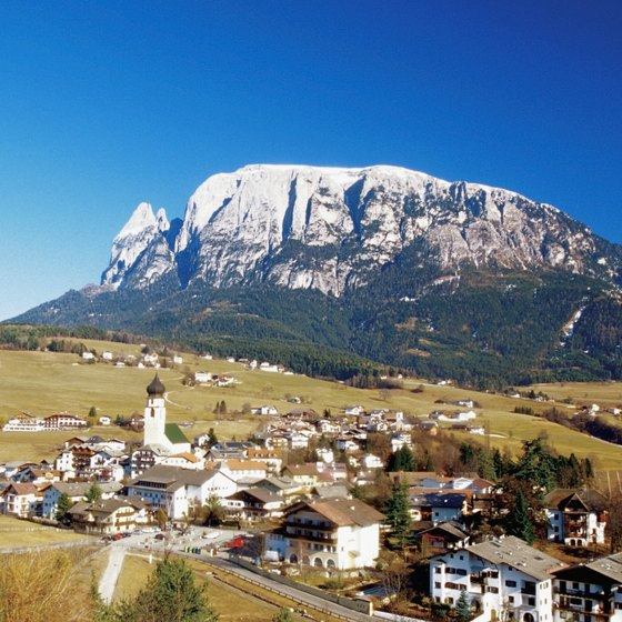 The Dolomite landscape features mountain peaks and valley villages.